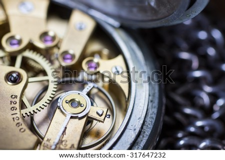 Macro photo of an old vintage pocket watch movement - stock photo