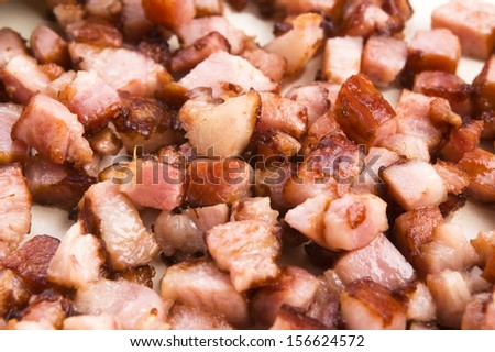 Macro photo of bacon being fried in a pan - stock photo
