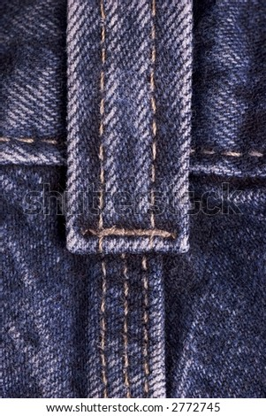 Macro photo of common blue jeans - stock photo