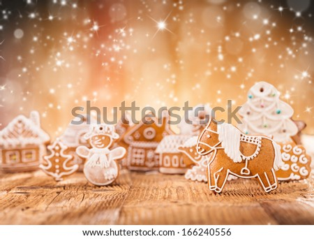 Macro photo of gingerbread village abstract blur background - stock photo
