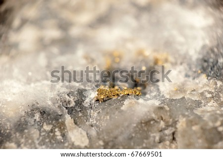 Macro photo of Gold Vein.  Showing Nuggets in the Stone - stock photo
