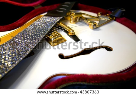 macro photo of golden electric guitar - stock photo
