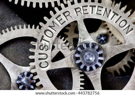 Macro photo of tooth wheel mechanism with CUSTOMER RETENTION concept letters - stock photo