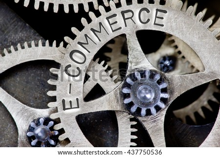 Macro photo of tooth wheel mechanism with E-COMMERCE concept letters - stock photo