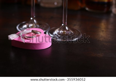 Macro photo of two classical simple wedding rings on the box in the form heart. Celebrating Valentine's Day, a marriage proposal. - stock photo