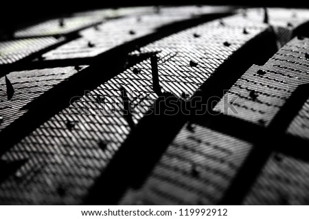 Macro photograph of a winter tire tread. Studio shot. Shallow DOF. - stock photo