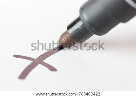 Macro photography of check mark on white background