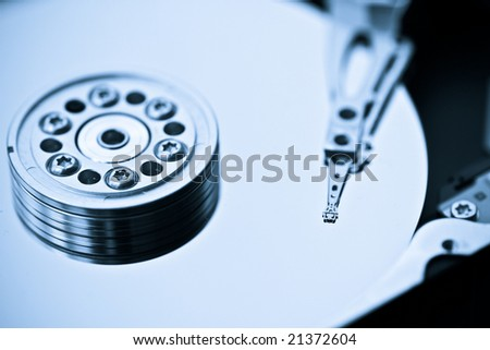 Macro picture of a hard drive disk. - stock photo