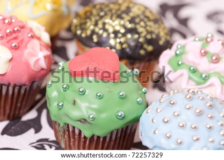 macro picture of multi colored cup cakes