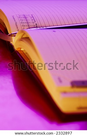 macro picture of open writing book in  pink color - stock photo