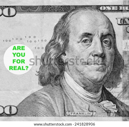 "Macro portrait of Benjamin Franklin from hundred-dollar U.S. bill with word balloon: ""Are you for real?"" (in black and white, except for green text; some identifiers have been removed) - stock photo"