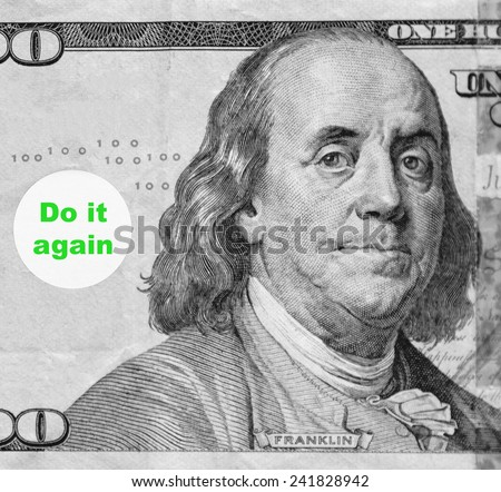 "Macro portrait of Benjamin Franklin from hundred-dollar U.S. bill with word balloon: ""Do it again"" (in black and white, except for green text; some identifiers have been removed) - stock photo"