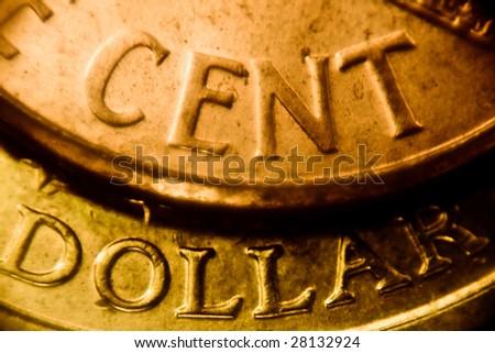 macro rare gold cent and dollar coin - stock photo
