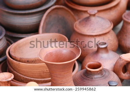 macro several types of clay pottery pots, pitchers, teapots at the fair in the summer - stock photo