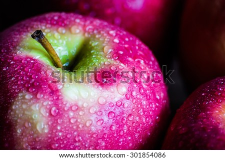 Macro shoot of an apple with drops of water on it - stock photo