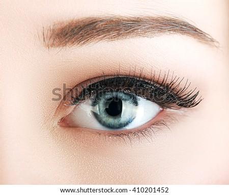 macro shoot of woman's eye with natural make up and black arrow - stock photo