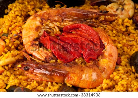 Macro shoot Tradition Seafood Spanish Paella in Pan, this is a typical spanish dish. - stock photo