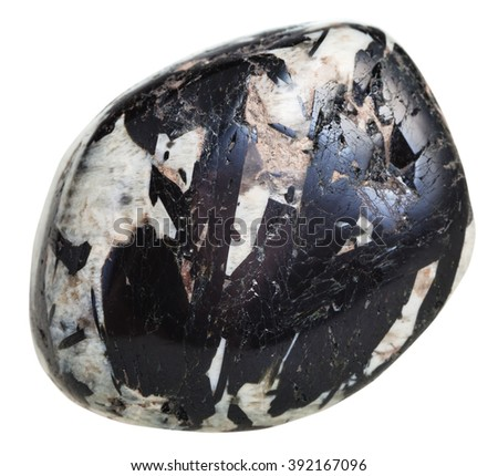macro shooting of natural gemstone - polished black Aegirine in Microcline mineral gem stone isolated on white background