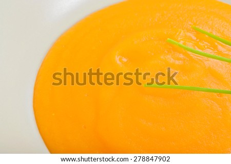 Macro shot from above of delicious healthy pumpkin soup in a light dish - stock photo