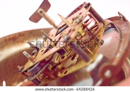 Macro shot inside a clock mechanism, Low depth of field, focus on cog - stock photo
