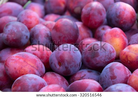 Macro shot of a bucket of plums