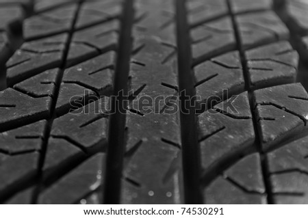 Macro shot of a car tire tread - stock photo