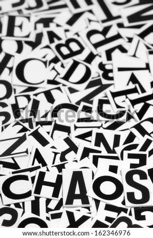 Macro shot of a clipped letters formed the word chaos - stock photo