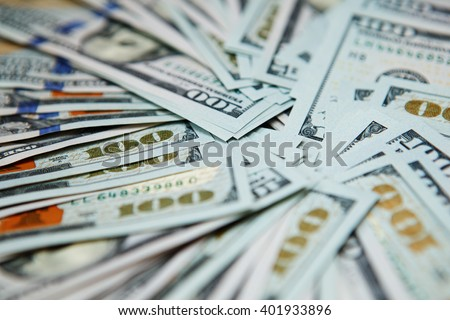 Macro shot of a 100 dollars. Dollar banknotes 100 Dollars currency of the United States useful as a background - stock photo