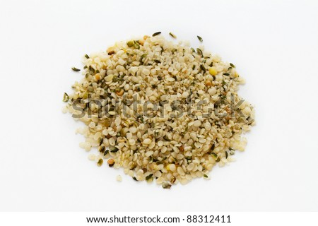 macro shot of a heap of shelled hempseed - stock photo