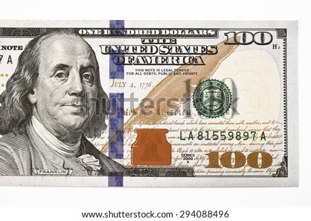Macro shot of a new 100 dollar bill isolate on white background - stock photo