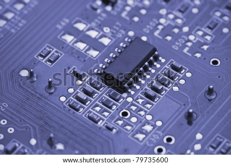 Macro shot of a printed circuit board with details of connection and chip - stock photo