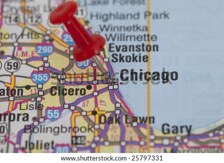 macro shot of a red push pin pointing on chicago - stock photo