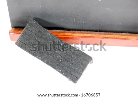 Macro shot of a small blackboard and eraser - stock photo