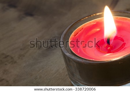 Macro shot of a small Tea light - stock photo