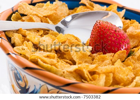Macro shot of a strawberry with corn flakes. Focus on the strawberry. Part of the breakfast series images.
