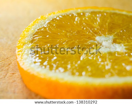 Macro shot of an orange slice. shallow depth of field. - stock photo