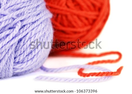 Macro shot of balls of purple and orange wool or yarn, great colorful craft background.