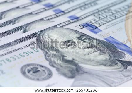Macro shot of Benjamin Franklin 100 dollar bill, shallow depth of field - stock photo