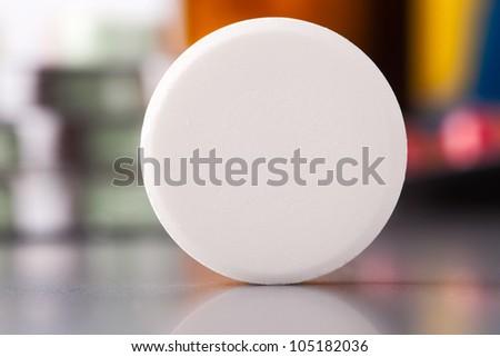 macro shot of big round pill - stock photo