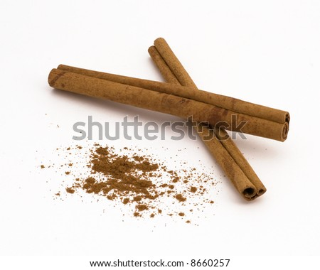 Macro shot of cinnamon (actually cassia) sticks and ground cinnamon One in a current series of 6 multi-form spice macros. - stock photo