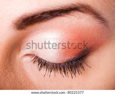 Macro shot of closed female eye with clorful make up - stock photo