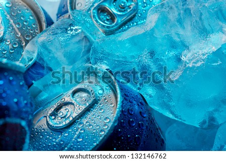 Macro shot of frozen drink cans and ice