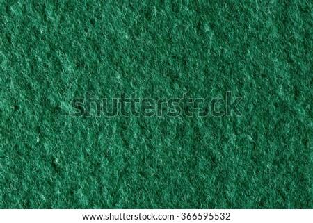 Macro shot of green felt tissue cloth, closeup texture. - stock photo