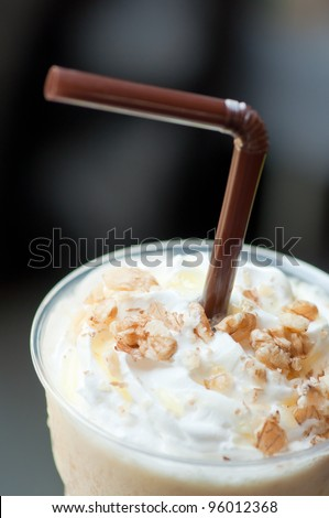 macro shot of ice coffee with beans - stock photo