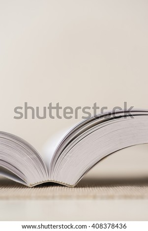 Macro shot of open book. Shallow depth of field. Vertical. - stock photo