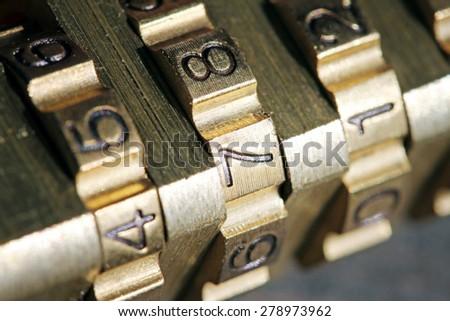 macro shot of padlock combination numbers - stock photo