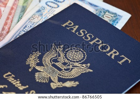 Macro shot of passport and foreign currency - stock photo