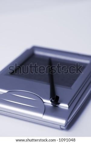 macro shot of personal digital assistant - stock photo