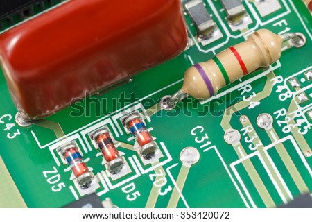 Macro shot of printed circuit board (PCB) with resistors, diodes and capacitors. - stock photo