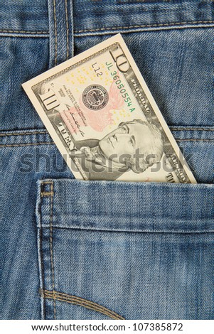 Macro shot of trendy jeans with american 10 dollar bill on its pocket - stock photo